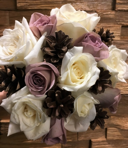 cone and roses in a rustic style wedding flowers