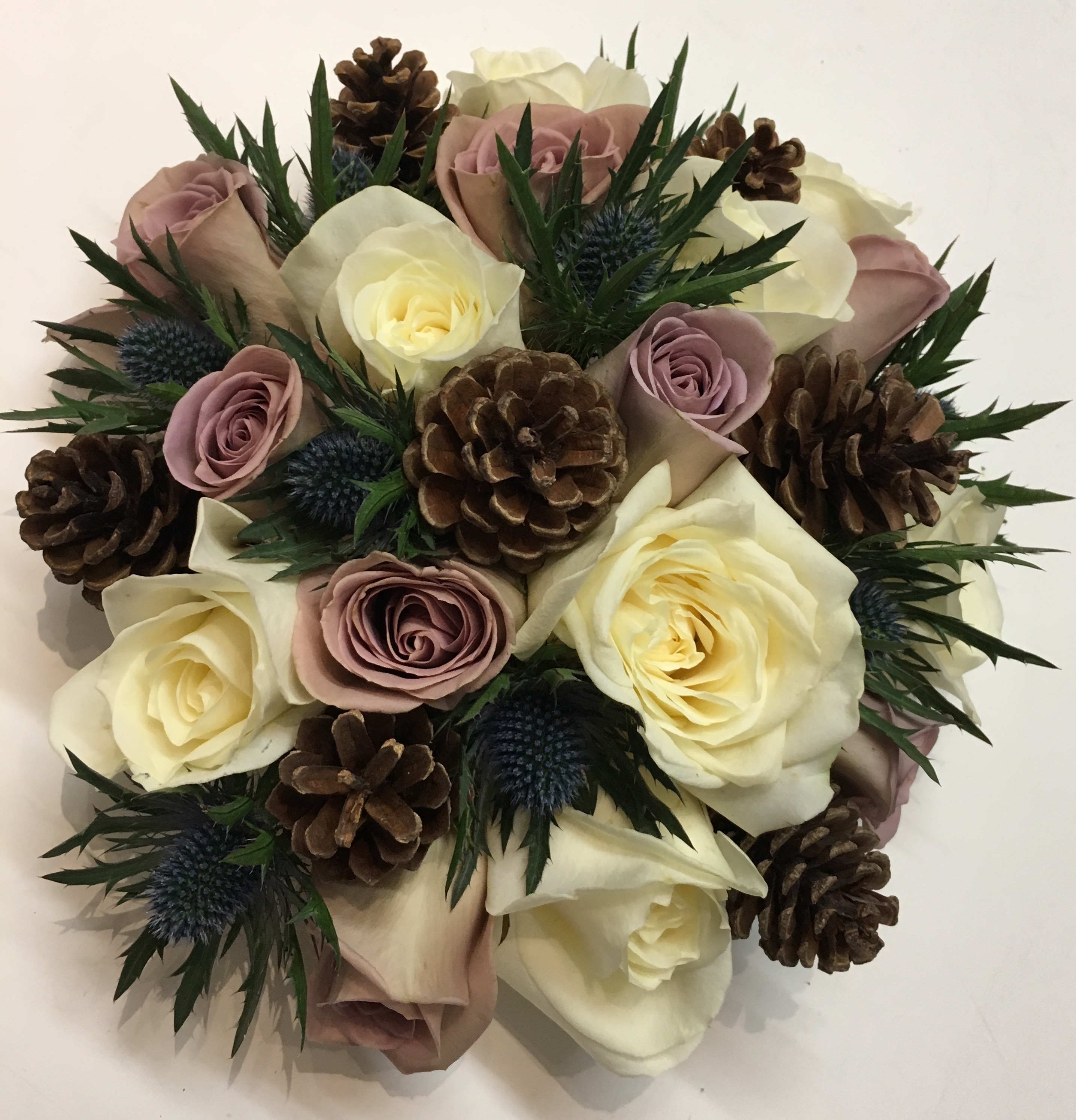 cone thistle and roses in a rustic style wedding flowers