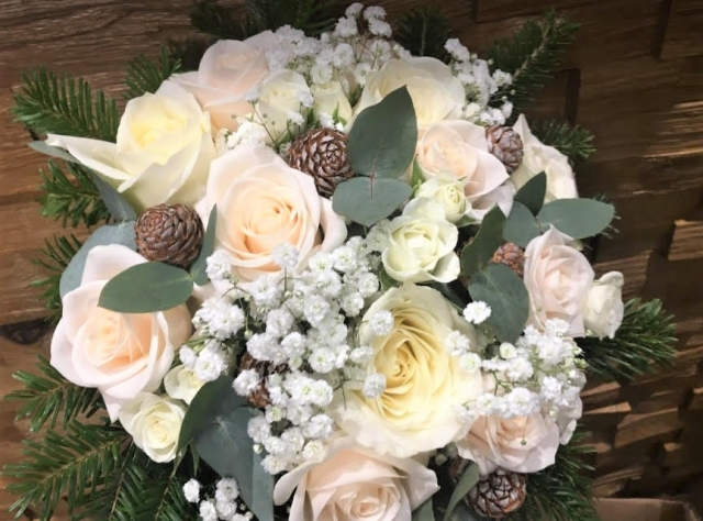 bridal bouquet of roses cones   gypsophila eucalyptus