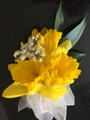 yellow daffodil ivory bow ladies buttonhole