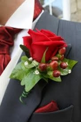 christmas buttonhole red rose hyperican berry grey suit flower