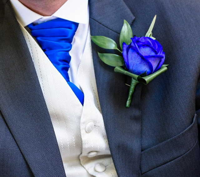 blue cravat blue rose mens buttonhole