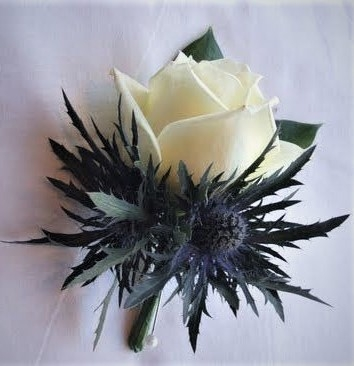 blue suit scottish theme buttonhole