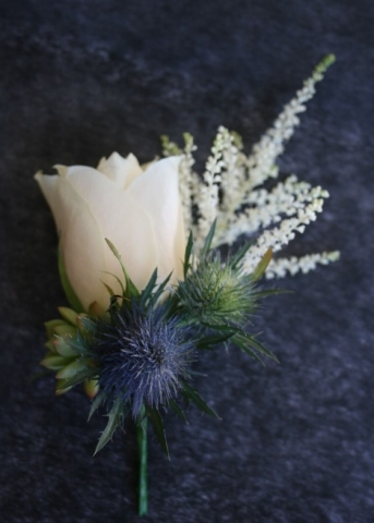 succulent thistle astilbe bridal party buttonholes