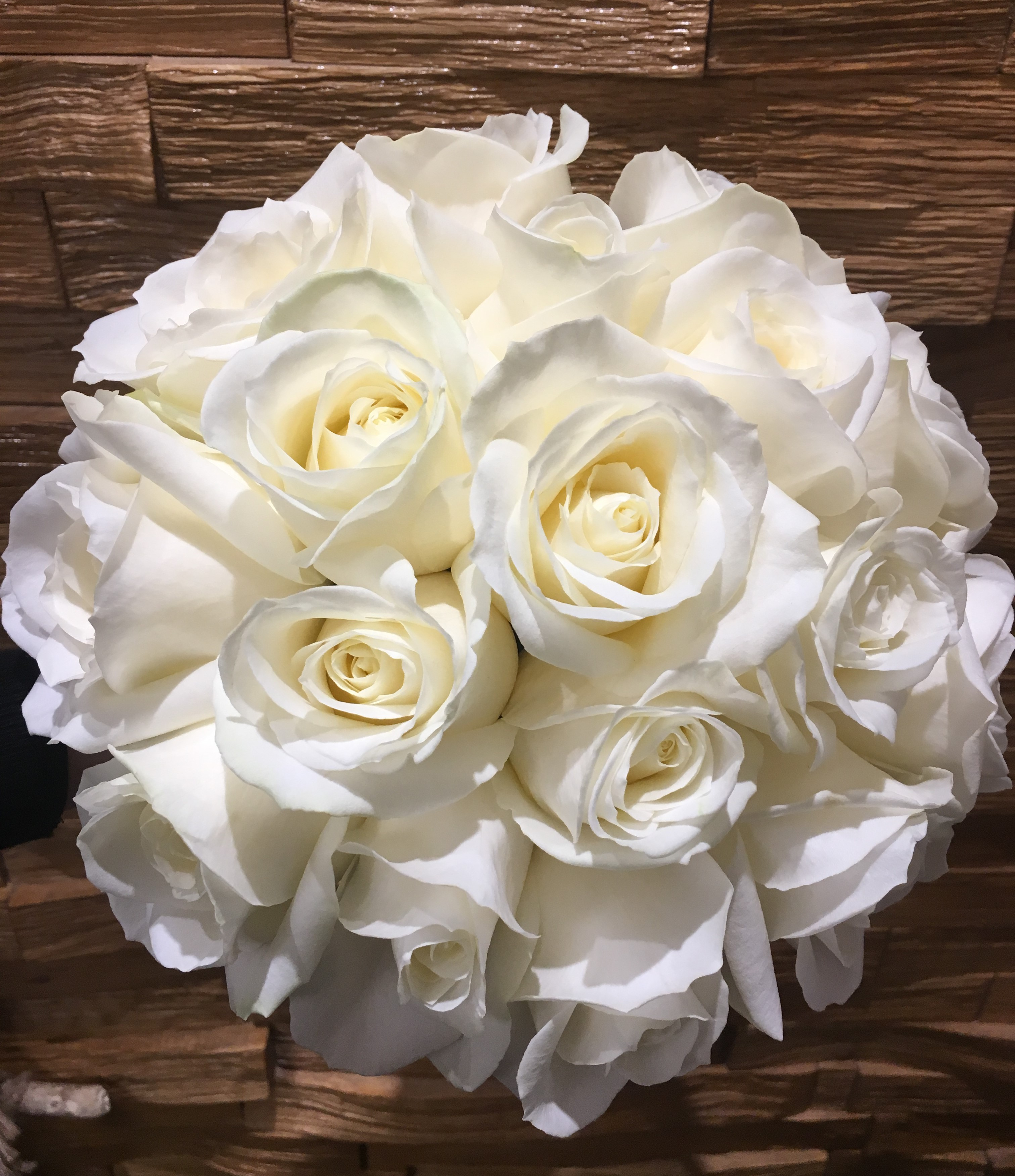 wedding flowers for bride in a hand tied style just white roses