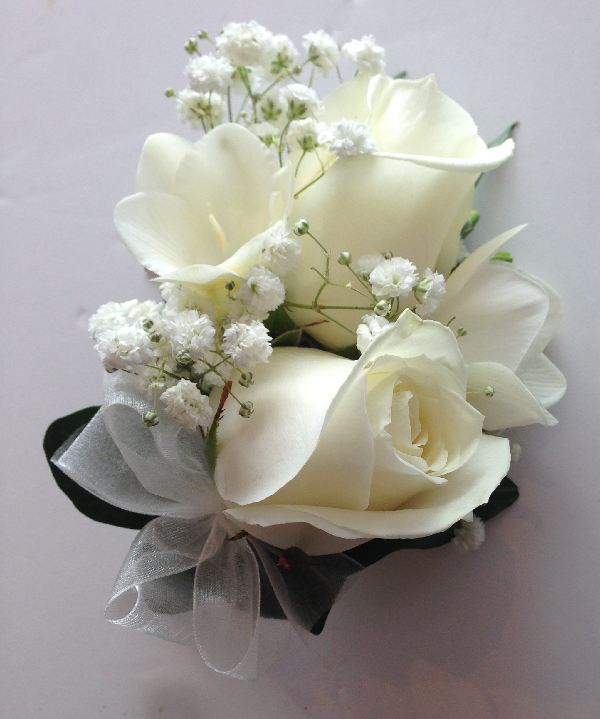 freesia roses gyp ladies corsage ivory flowers