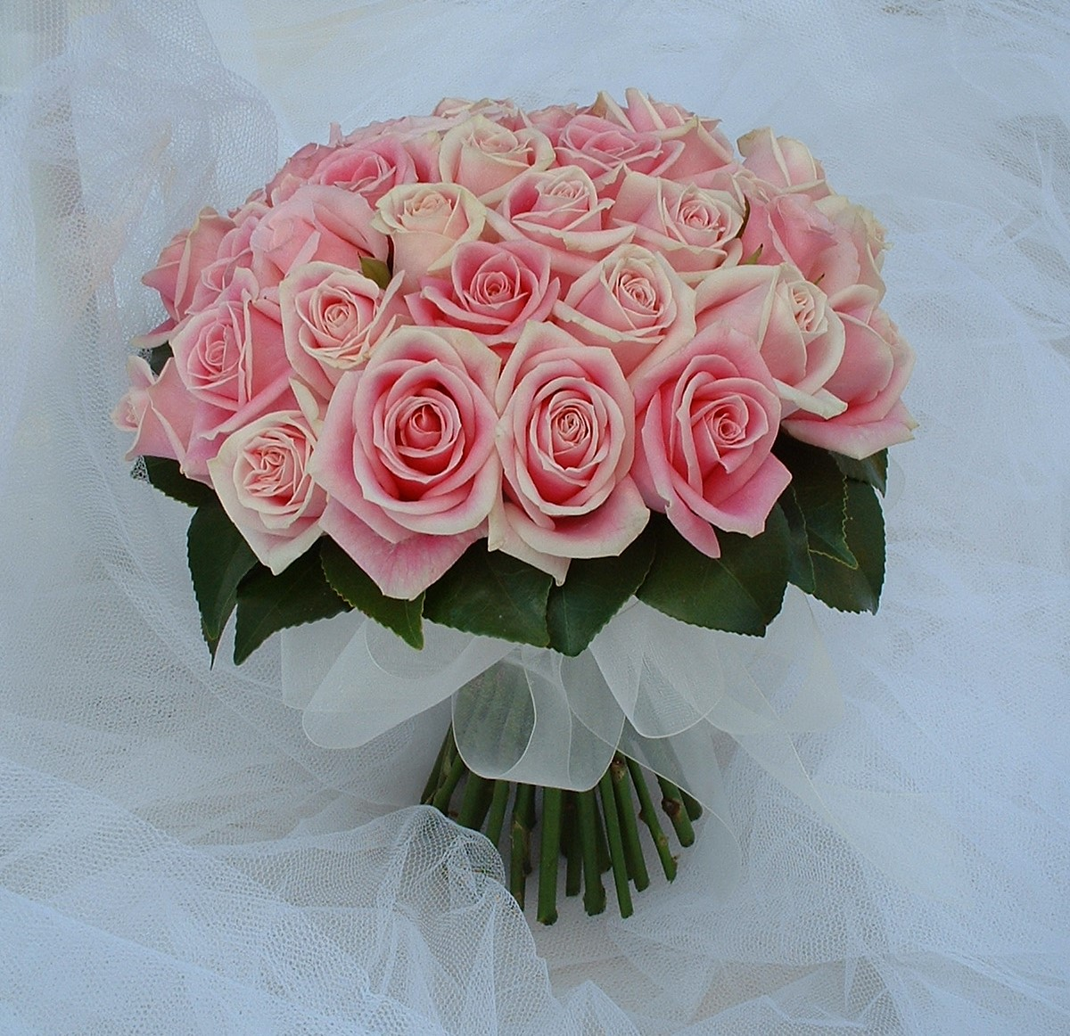 wedding flowers for bride in a hand tied style just pink roses