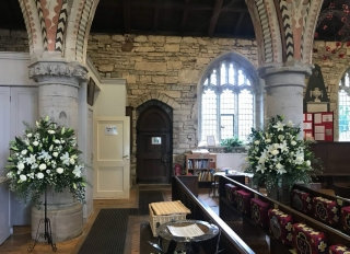 pedestal white lily & ivory roses church flowers