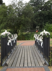 pew ends & bows with posy pad on bridge ardencote manor
