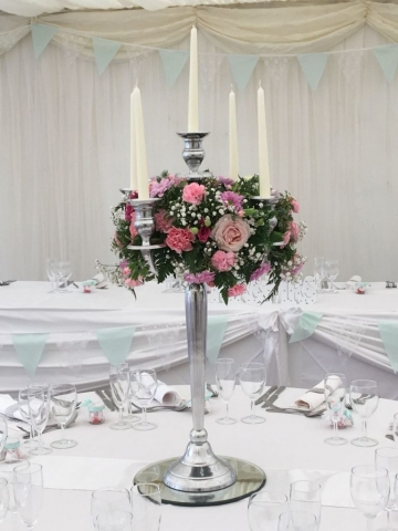 Pink carnations white flowers candelabra