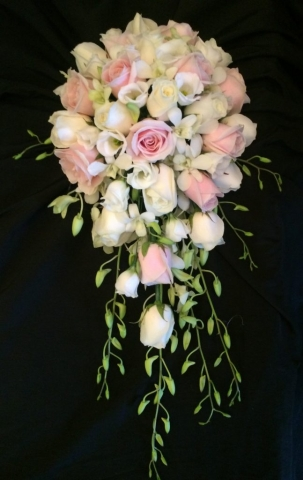 shower bouquet lisianthus  white rose and white freesia calla and singapore orchids shower wedding bouquet