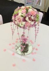 Vintage style tall vase arrangement at Bordesley Park