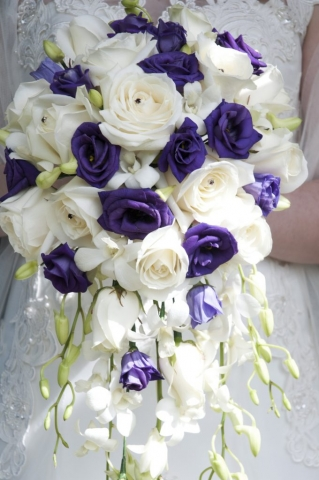 purple shower bouquet purple lisianthus  white rose and white freesia calla and singapore orchids shower wedding bouquet