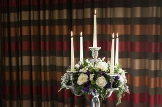 purple  white flowers candelabra abbey hotel