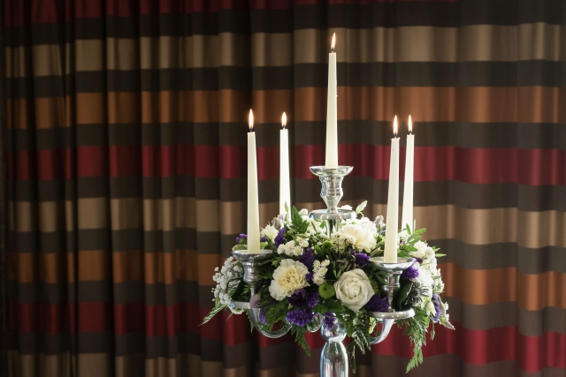 purple  white flowers candelabra abbey hotel