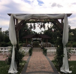 swags on arch Swags on arch rustic look aisle outside weddings Wootton  Park
