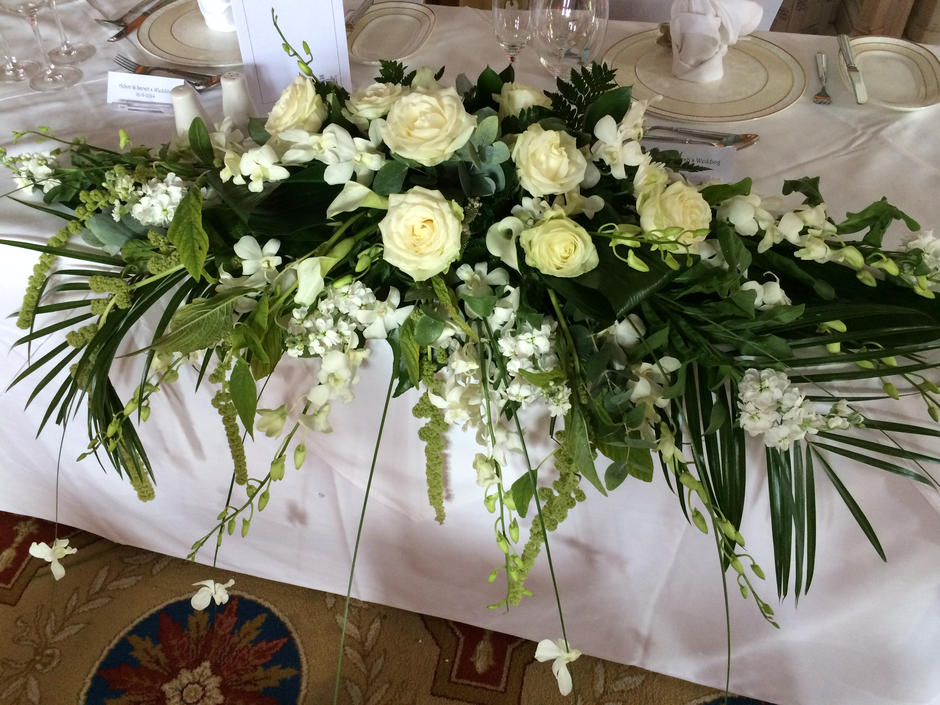 top table white flowers Top table arrangement with flowing orchids and roses at Studley Castle