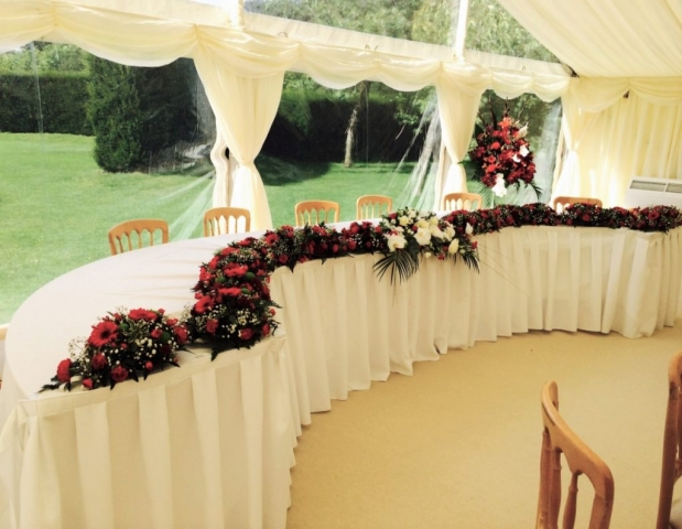 top table flowers gerbera red & white flowers Top table with flowers from church transfer of flowers coughton court