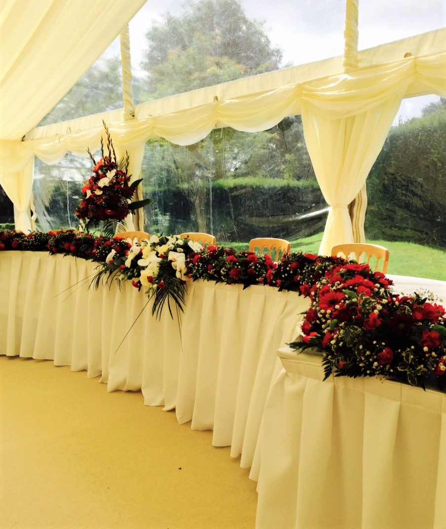 Top table with flowers from church transfer of flowers coughton court