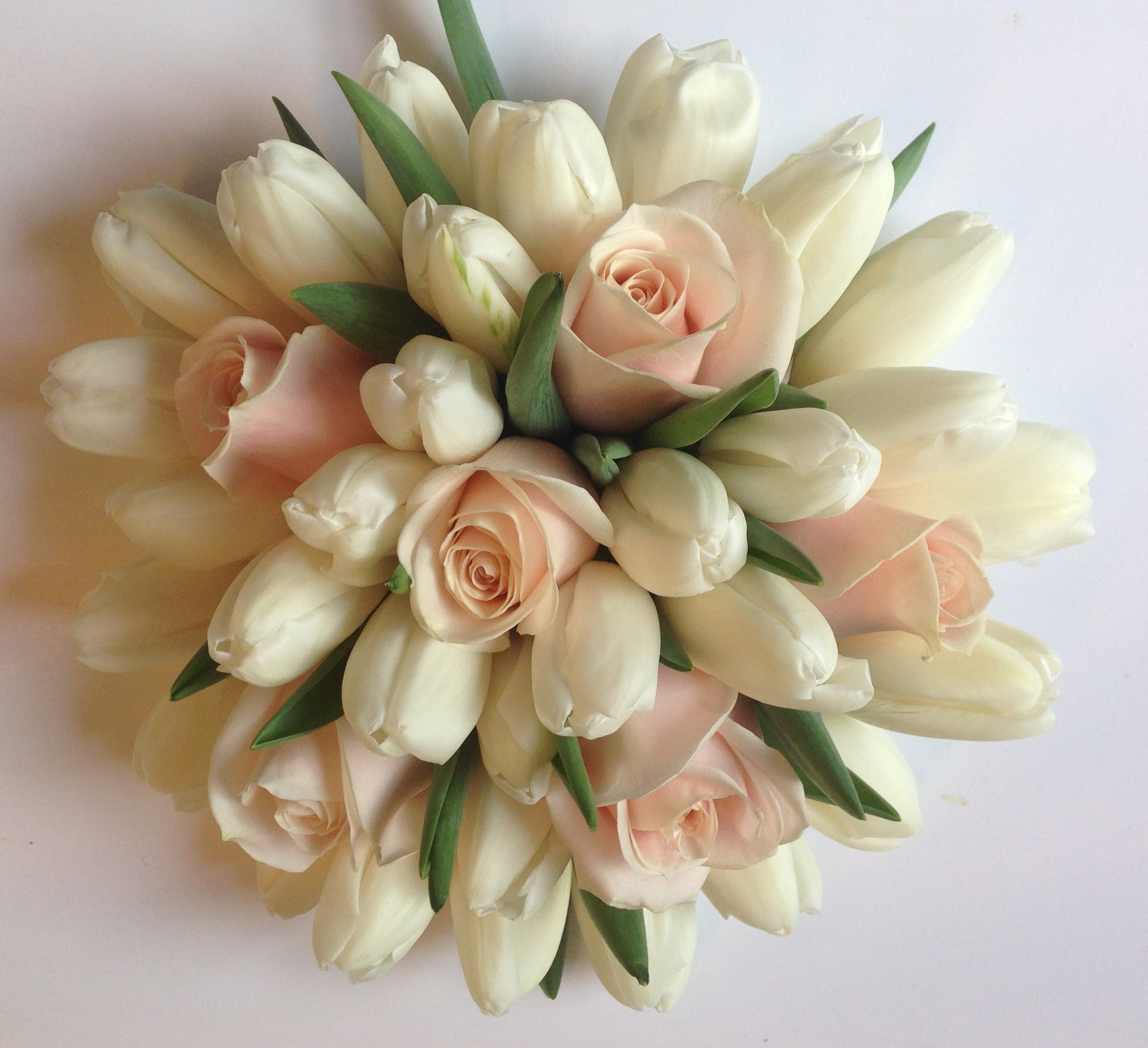 tulips and roses in pastel shades hand tied wedding flowers