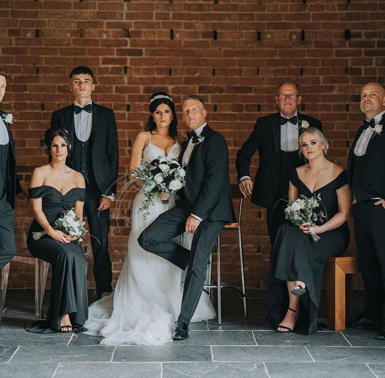 black wedding flowers with grey foliage and white roses