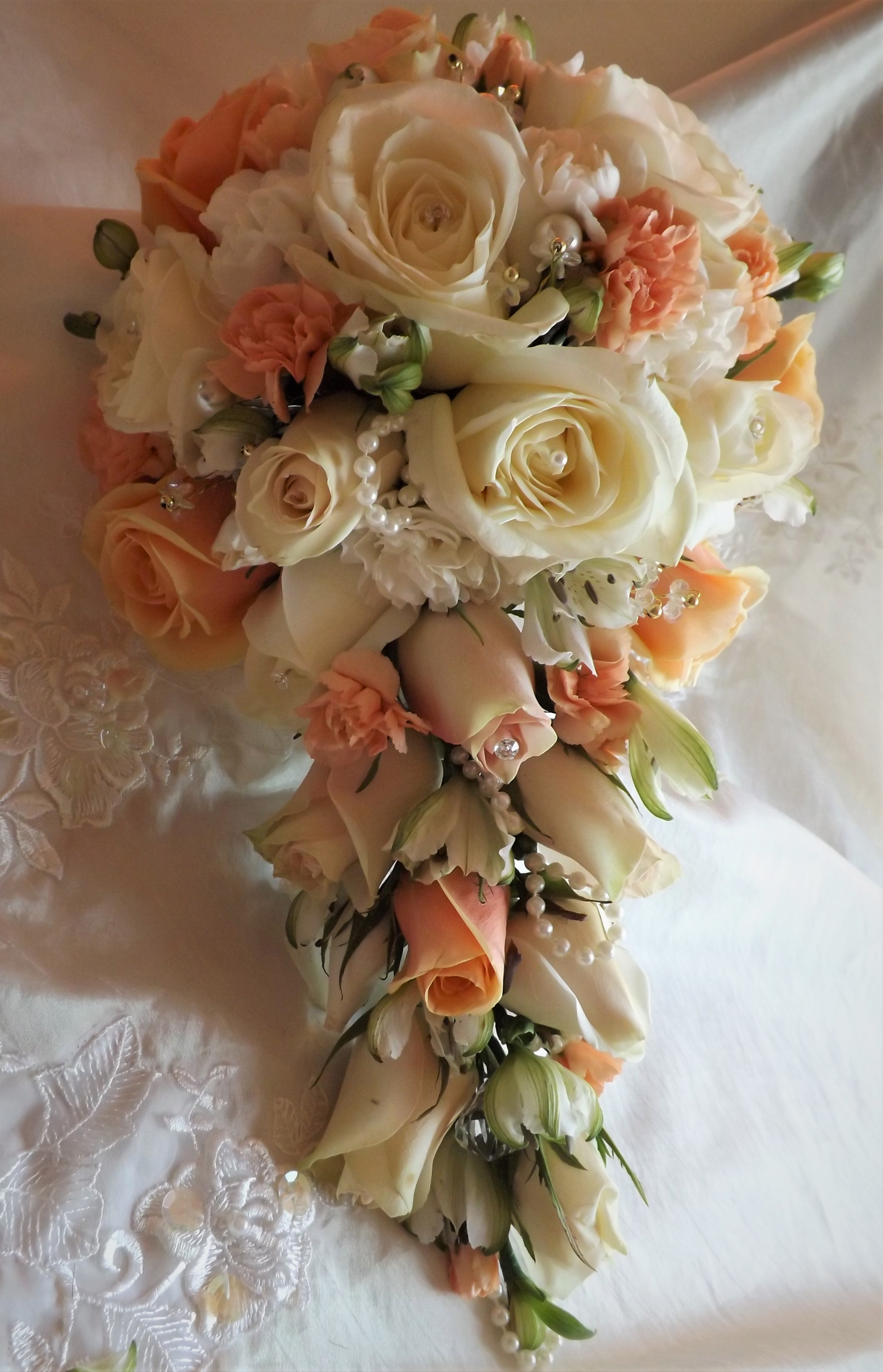 peach shower bouquet lisianthus white rose and white freesia calla and singapore orchids shower wedding bouquet