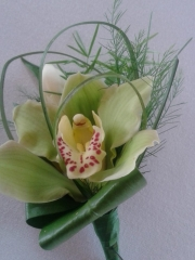 green orchid buttonhole