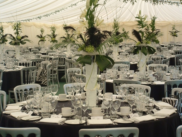 White lily table arrangement in marquee