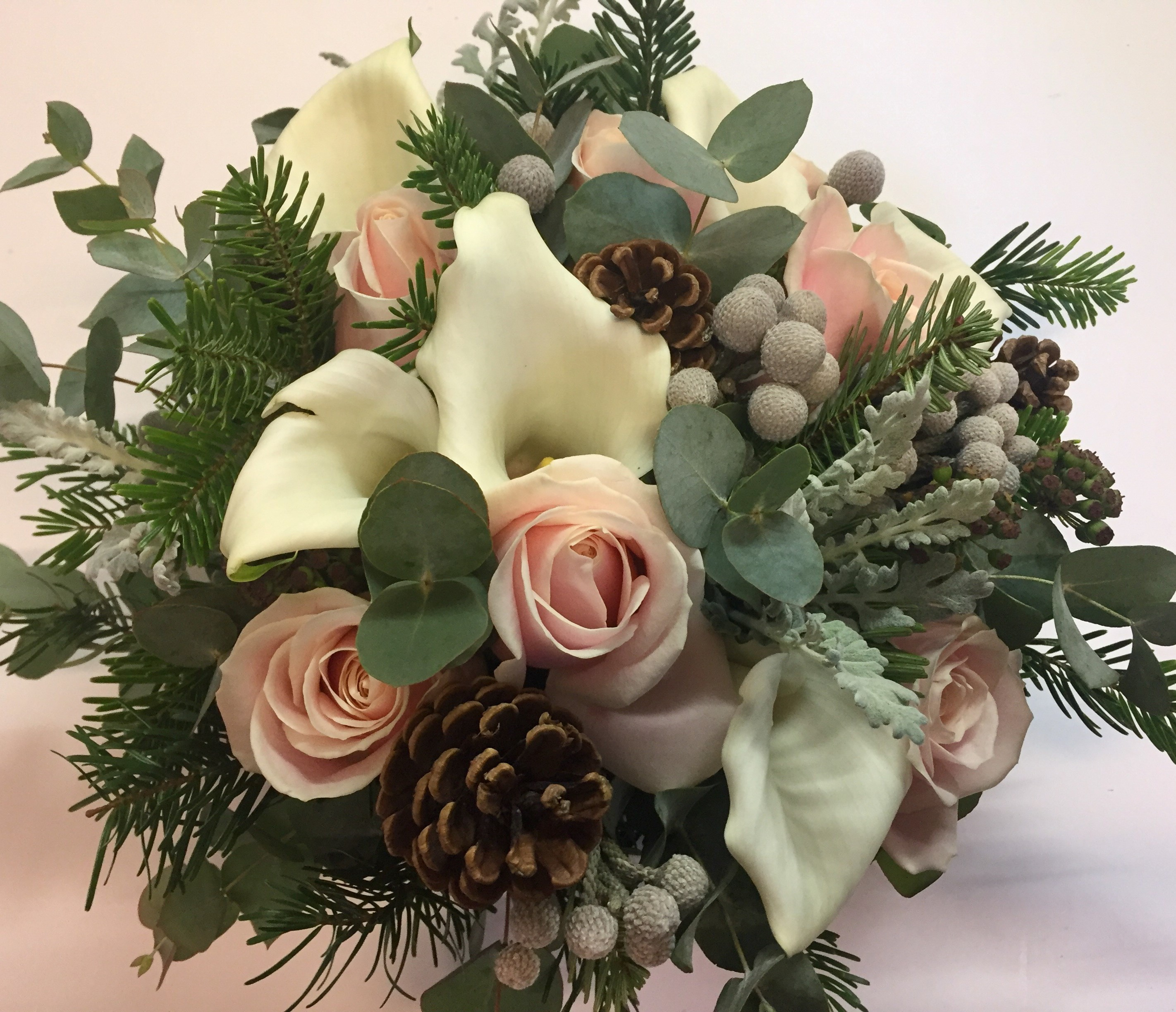 wild look white  calla and pale pink roses with cones and berries wedding hand tied bouquet