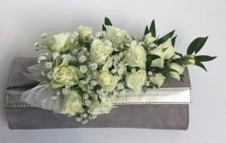 womans grey handbag spray ivory spray roses