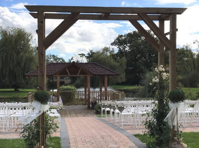 wootton park gyp wicker baskets down aisle Swags on arch rustic look aisle outside weddings Wootton  Park