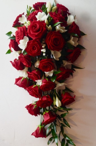 red rose and white freesia shower wedding bouquet