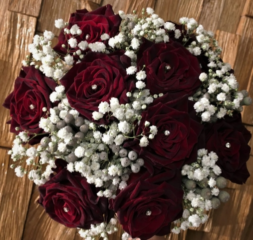 deep burgundy roses  flowers in bouquet hand tied bouquet