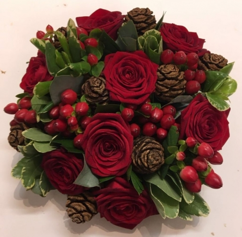 bridal flowers in a hand tied red roses hyperican cones