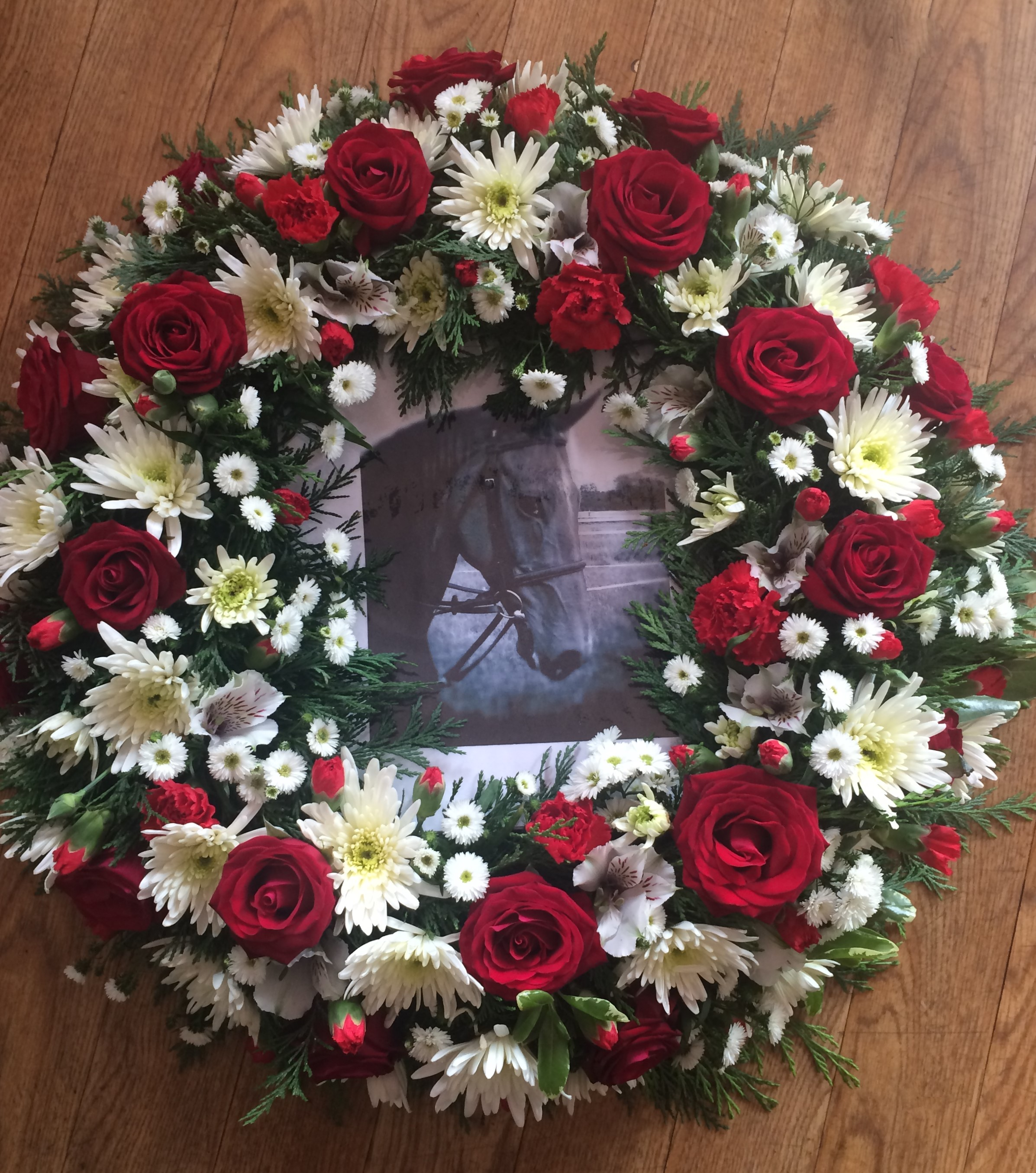 wreath with a horse racing design