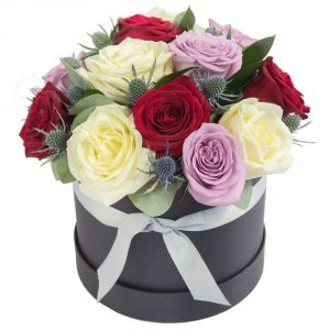 a luxurious hat box filled with romantic shade mixed roses