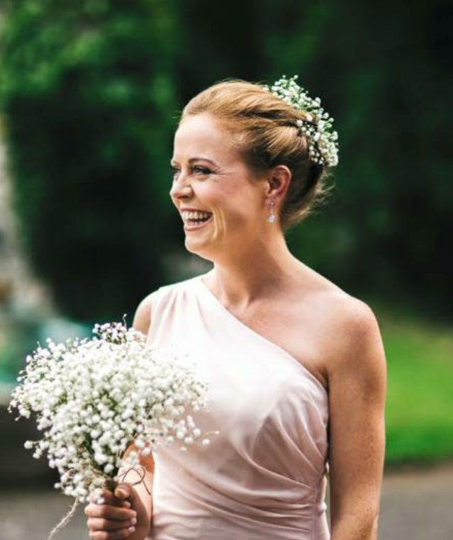 Bridesmaids handtied bouquet and hair flowers