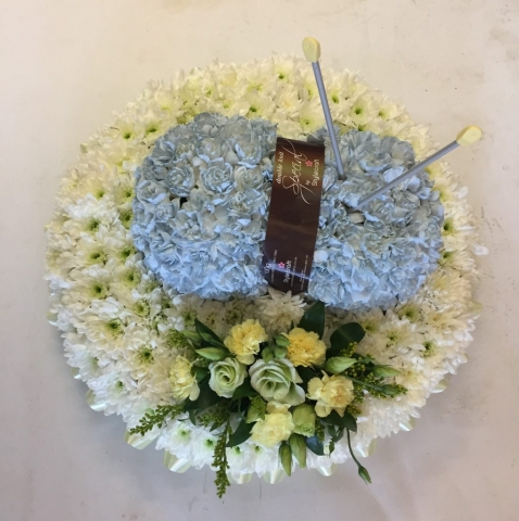 Bespoke Knitting Tribute in a Design of a Ball of Wool and Knitting Needles REDDITCH FLORIST, FUNERAL ITEM, PERSONAL FLOWERS.