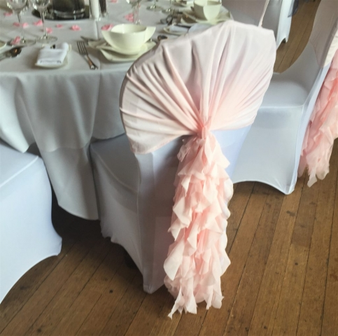blush pink ruffled chair hood