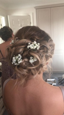 Simple bridesmaids hair flowers