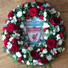 bespoke funeral tribute fresh flowers for a football player football fan unusual design