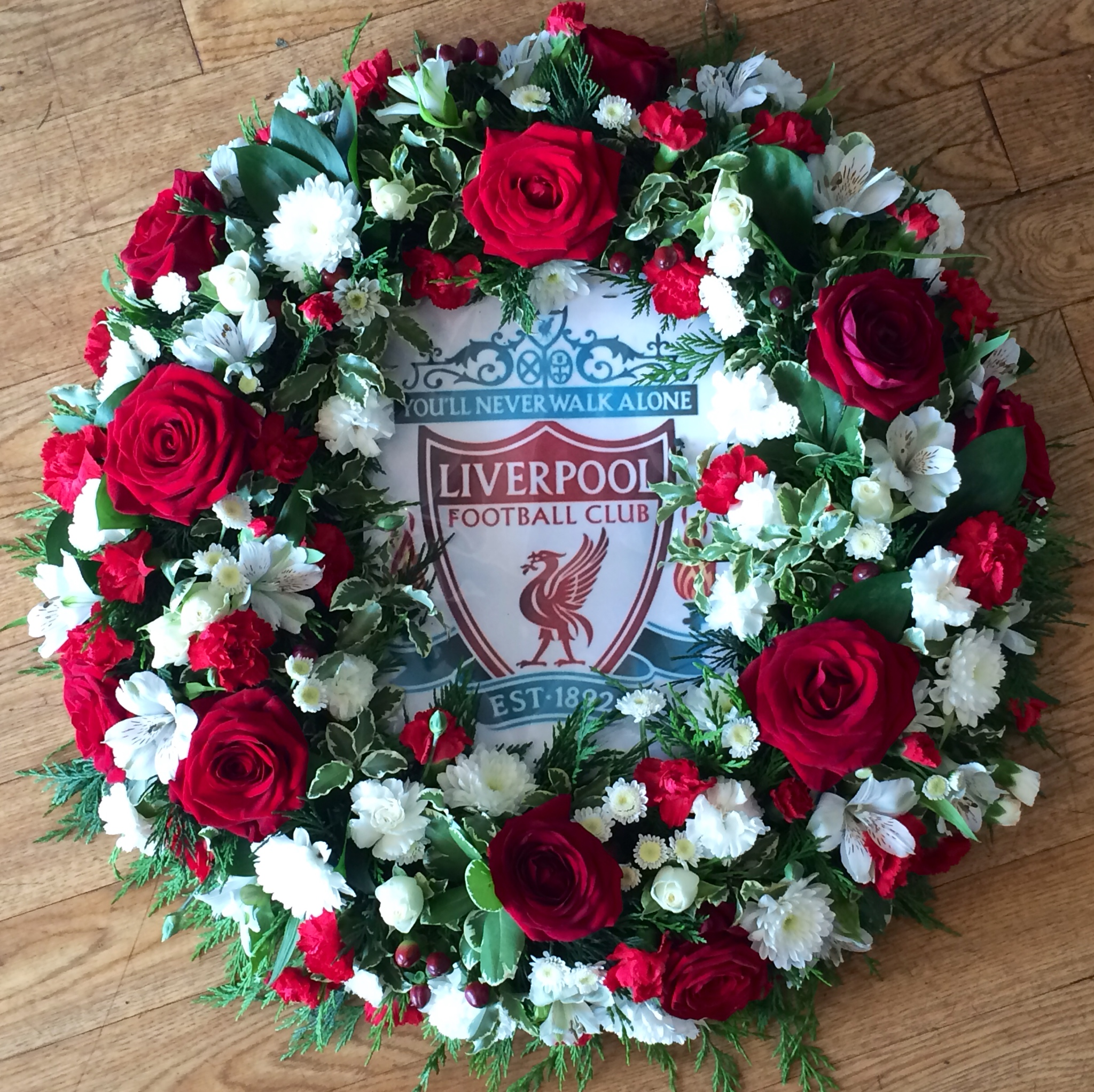 bespoke funeral tribute fresh flowers for a football player football fan unusual design
