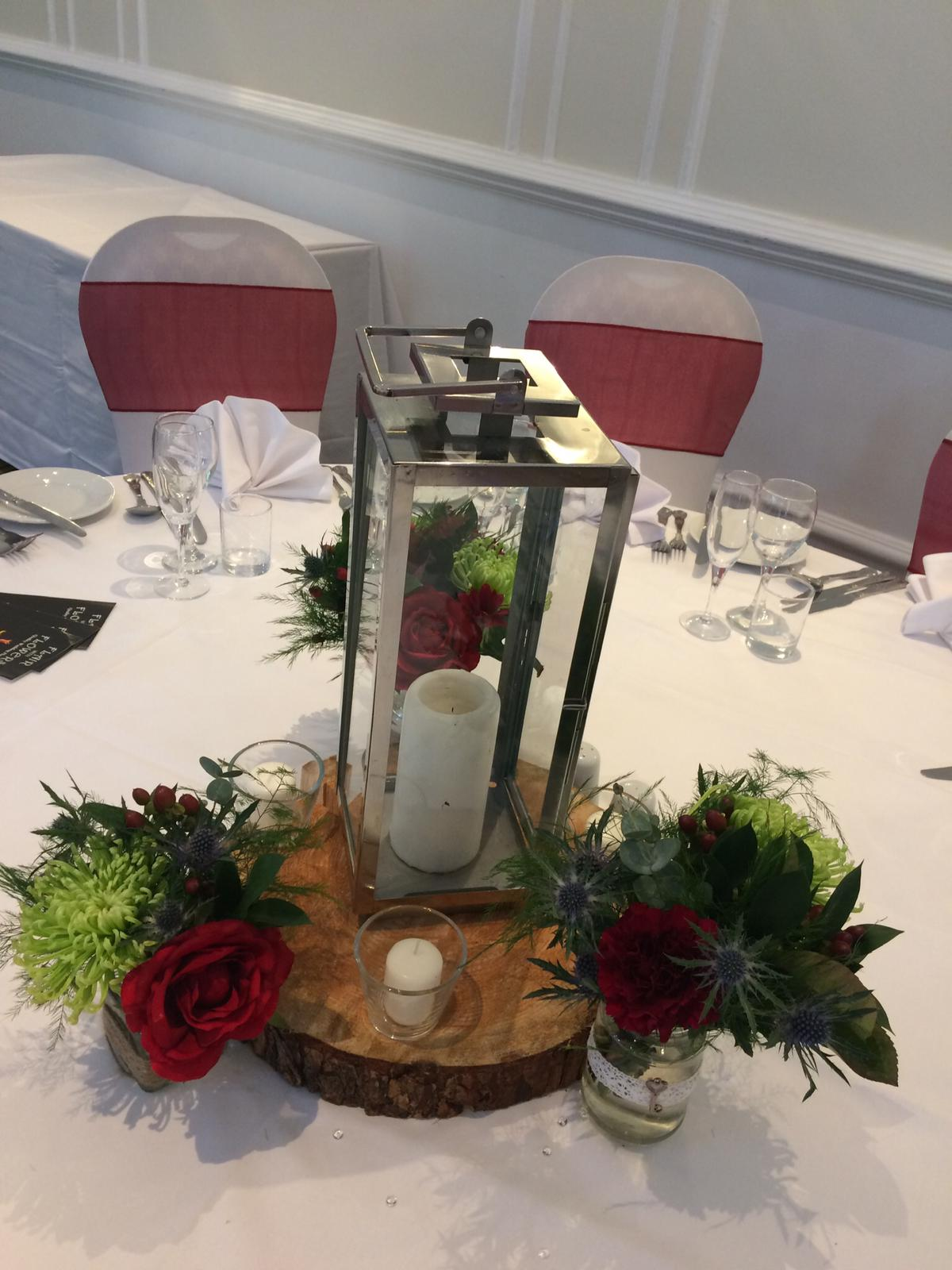 lantern and logs for hire with tea lights and jam jar flowers SOUTH CREST HOTEL