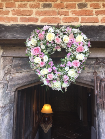 Heart of flowers over the entrance of Gorcott Hall