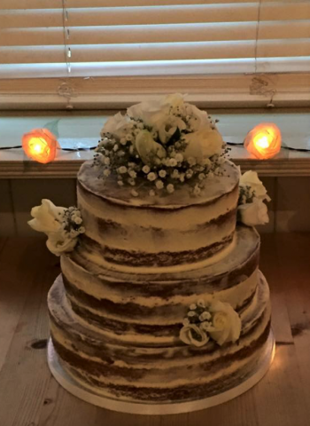 frosted naked cake with ivory flowers cake flowers 5