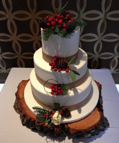 cake flowers and wooden log base for hire for a rustic feel