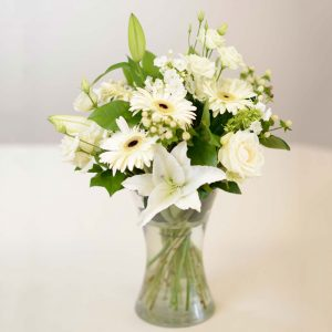 soft elegant display of roses and lilys