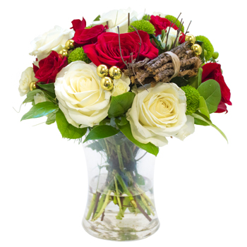 Hand tied festive bouquet in vase