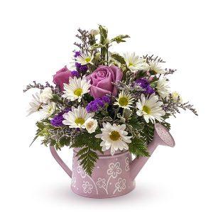 watering flower arrangement